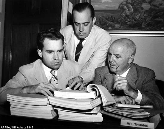 HUAC members (including Nixon) look for communists