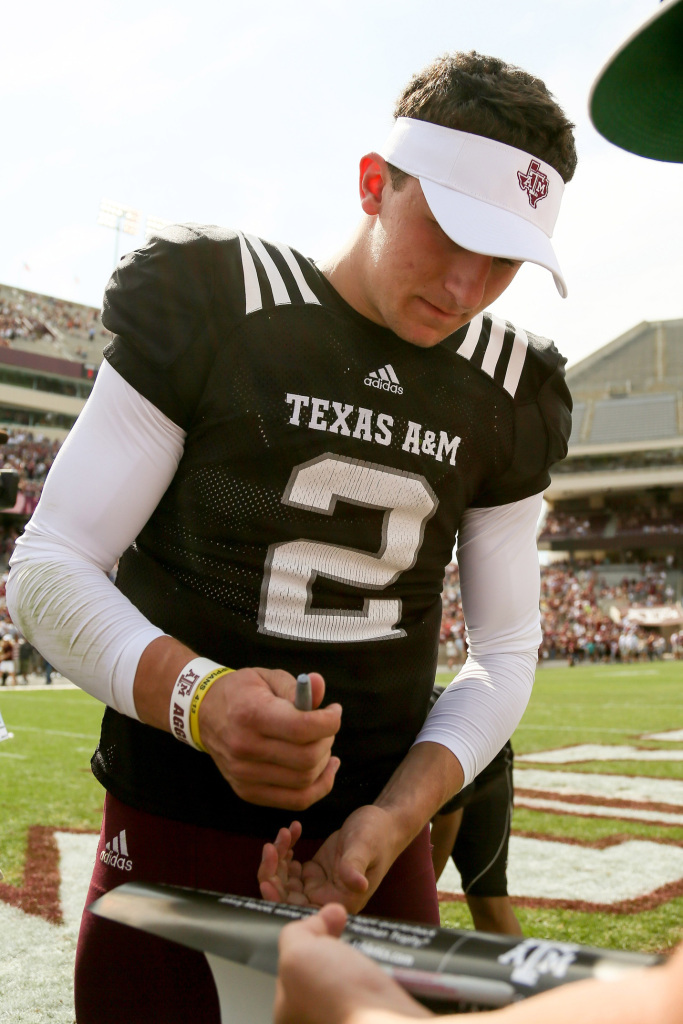 Johnny Manziel signing autographs