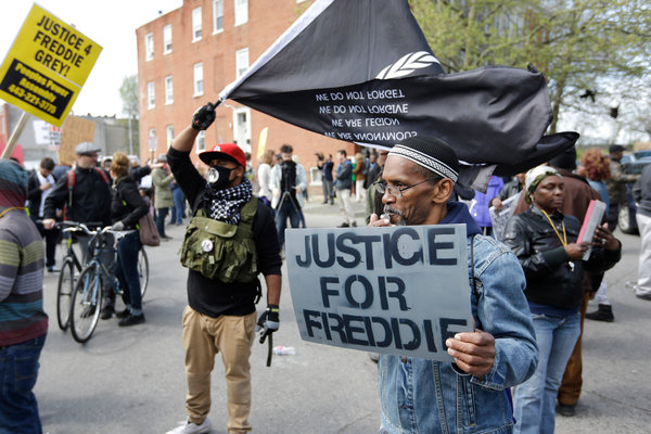 Protesters demonstrate before Baltimore police station