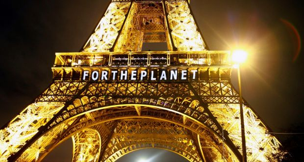 Eiffel Tower during climate talks. The energy efficient bulbs are powered in part by wind and sun.