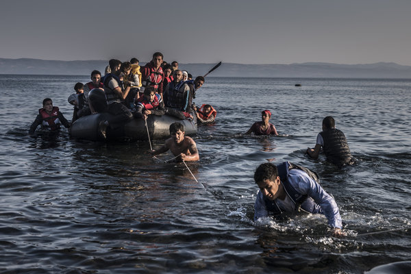 Syrian refugees pulling up on Lesbos