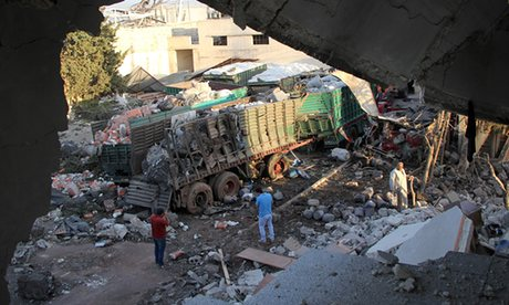 Bombed trucks that were carrying aid to Syrian civilians